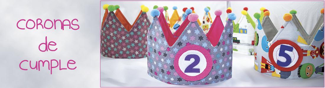 Coronas de cumpleaños hechas de tela, reversibles y con números intercambiables.