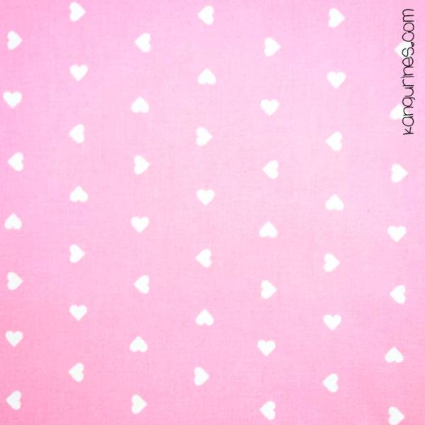 Corazones blancos fondo rosa pastel